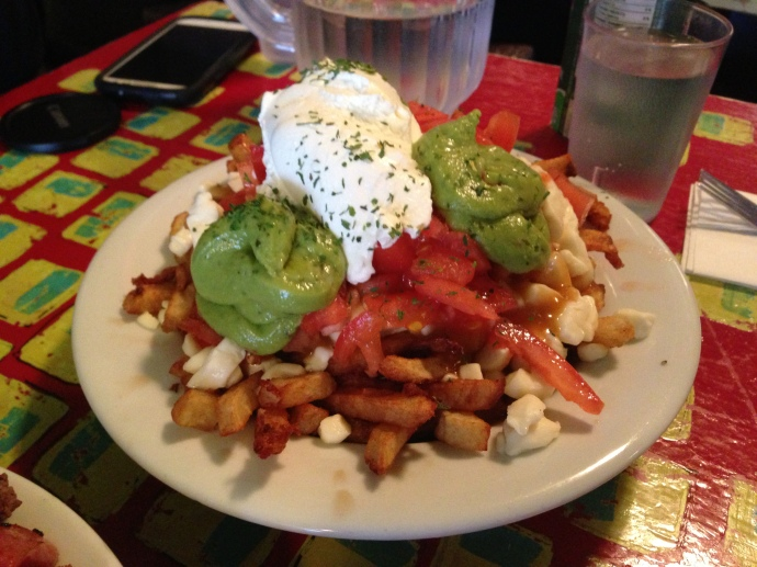 La Taquise: sour cream, guacamole, and tomatoes ~  $8.95/13.60